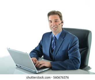 Business man on a call while working on laptop up or customer service representative helping people