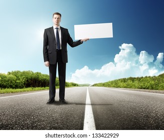 business man on the road whith blank in hand