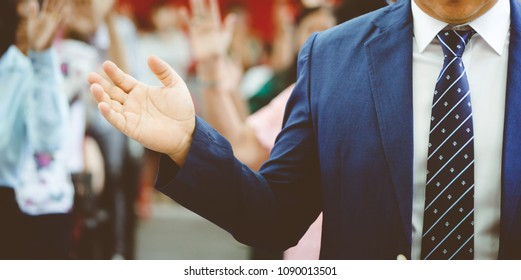 Business Man with open arms Pray and worship in church.Prayer concept for faith,spirituality and religion.