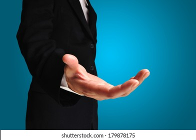 A business man with an open hand ready to seal a deal on white background with clipping path
