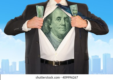 Business man opening his shirt in classic superhero style revealing Ben Franklin from the $100 bill representing success in the stock market, banking, monetary gains, marketing, sales and promotions.