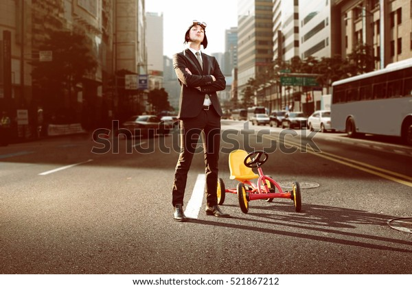 Business man with pedal car in the city