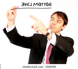 business man with pen over a white background writing the bottom line on the screen