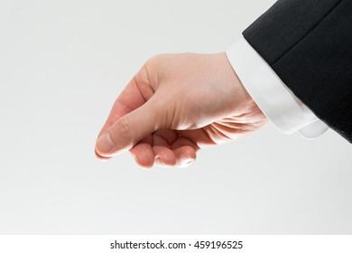 business man pinching or dropping something