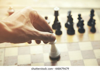 business man playing chess on studio background