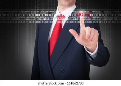 Business man pointing to a binary code. Technology concept