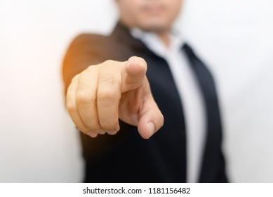 Business man pointing finger concept soft focus background