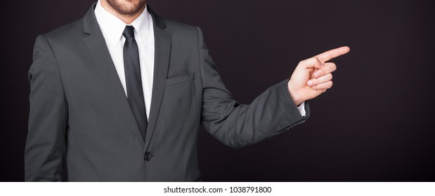 Business man pointing finger at copy space