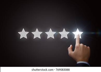 Business man pointing five star to increase the rating.