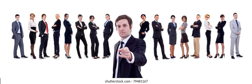 business man pointing with his team behind him
