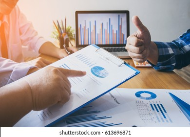 business man is pointing to leader financial results.