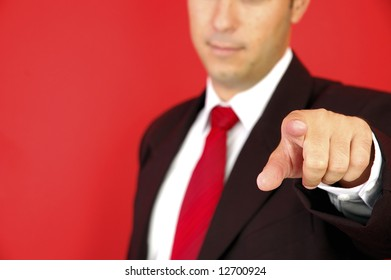 Business man pointing on the red background