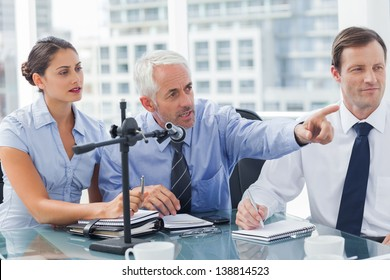 Business man pointing at something in a conference in the meeting room