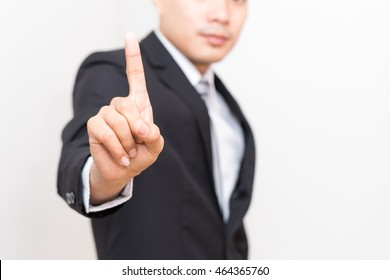 Business man with pointing to something on white background