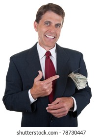 Business man pointing to a stack of dollar bills in his pocket.