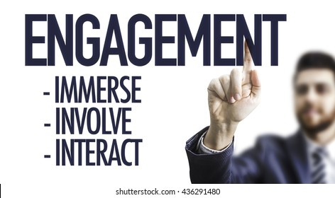 Business man pointing the text: Engagement