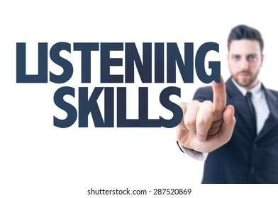 Business man pointing the text: Listening Skills