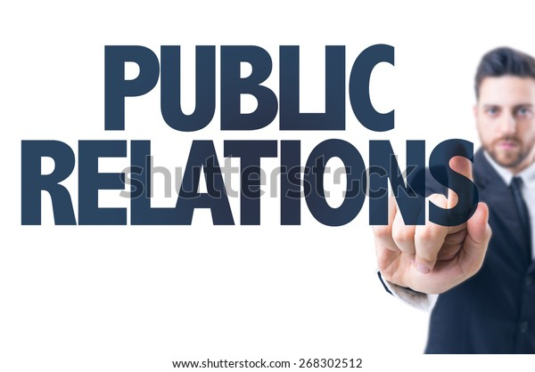 Business man pointing the text: Public Relations