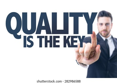 Business man pointing the text: Quality is the Key