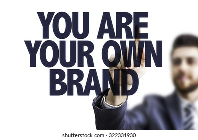 Business man pointing the text: You Are Your Own Brand