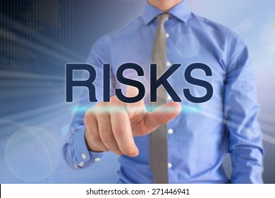 "Business Man Pointing At A Touch Screen ""Risks"""