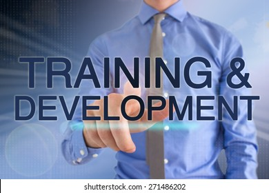 "Business Man Pointing At A Touch Screen ""Training & Development"""