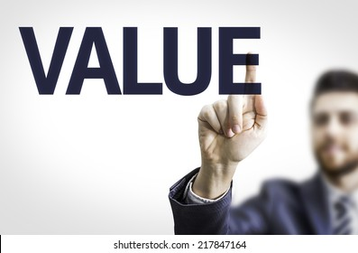 Business man pointing to transparent board with text: Value