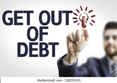 Business man pointing to transparent board with text: Get Out of Debt