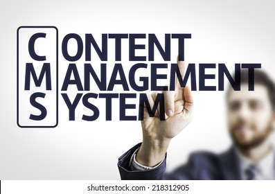 Business man pointing to transparent board with text: Content Management System