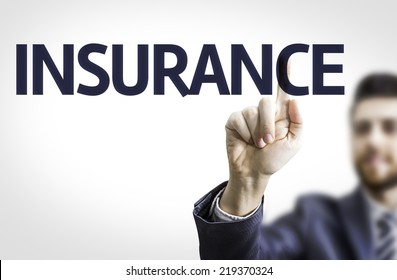 Business man pointing to transparent board with text: Insurance
