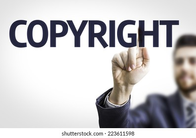 Business man pointing to transparent board with text: Copyright