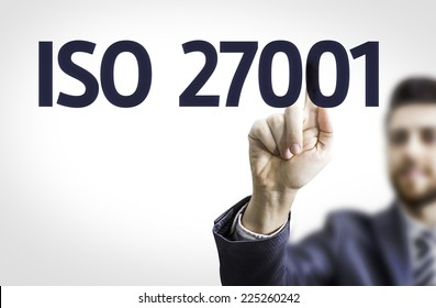 Business man pointing to transparent board with text: Iso 27001