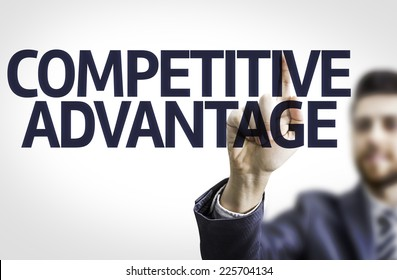 Business man pointing to transparent board with text: Competitive Advantage