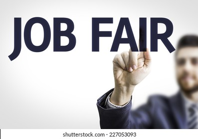 Business man pointing to transparent board with text: Job Fair