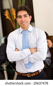 business man portrait in an office smiling