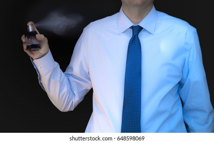 Business man prepares to go to the office. Sprinkles of after-scent fragrance