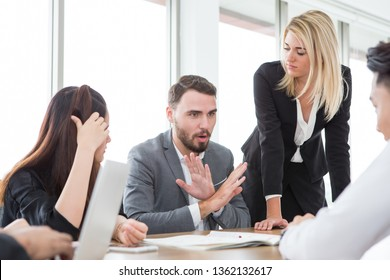business man presenting and disagree sign  in meeting room . Group of young business people brainstorming together in office. teamwork conference. discussing reject new plan