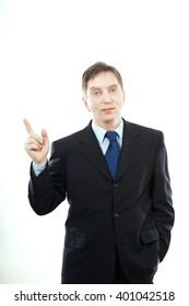 business man presenting something in the back with one hand in his pocket while looking at the camera with a smile on his face, on white background
