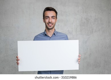 business man presenting a white sign