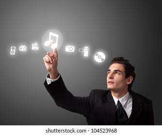 business man pressing a MUSIC button