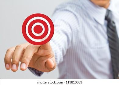 Business man pressing on target goal - Shutterstock ID 113810383