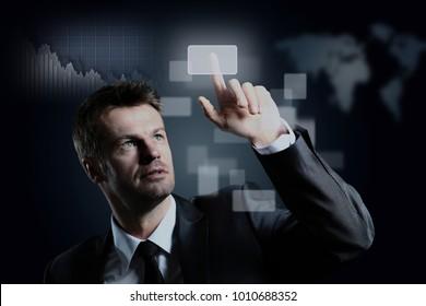 business man pressing a virtual button.