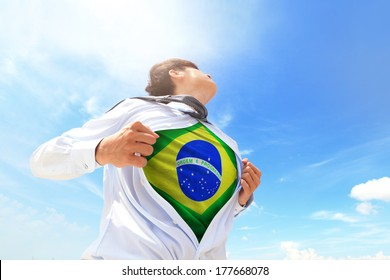 Business man pulling his t-shirt open, showing Brazil national flag