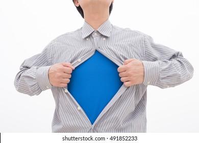 Business man pulling his t-shirt open, showing a superhero suit underneath his suit