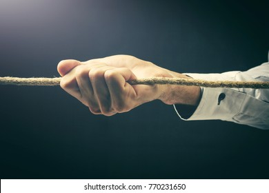business man pulling rope