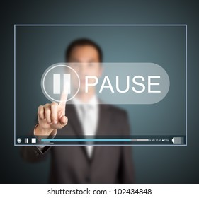 business man push pause button on touch screen to hold video clip