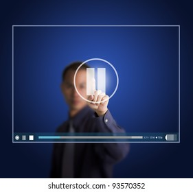 business man push pause button on touch screen to suspend video clip