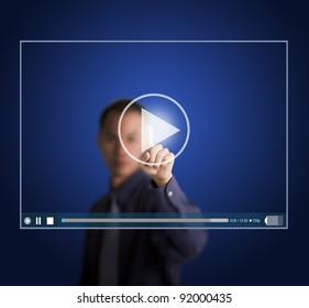 business man push start button on touch screen to run video clip