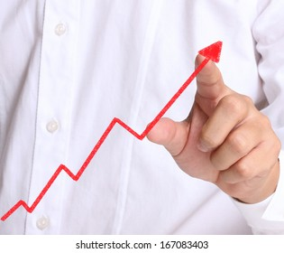 Business man pushing the graph