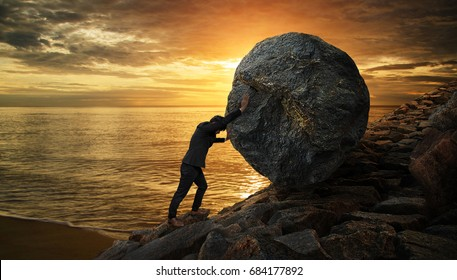 Business man pushing large stone up to hill , Business heavy tasks and problems concept.